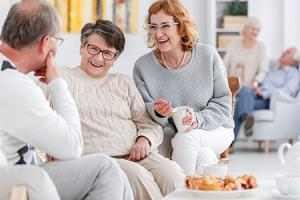 Senior club concept, group of elderly people talking and enjoying each other's company