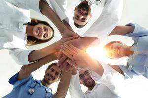 bottom view.a team of doctors at the medical center clasped their hands together.the concept of unity