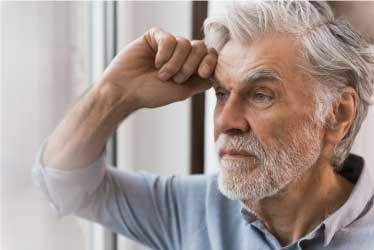 Elderly Man Concerned, with hand on forehead