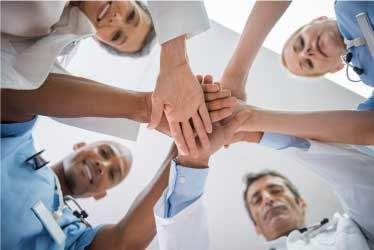 Doctors and Nurses in a huddle