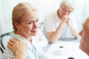 Elderly couple looking very stressed out