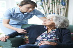 Home Care custodial nurse with patient