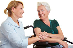 Home care nurse with patient in wheelchair