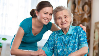 Home Care Nurse and senior patient happy
